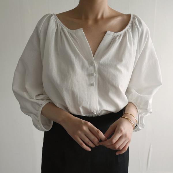 素雅排釦七分袖上衣
